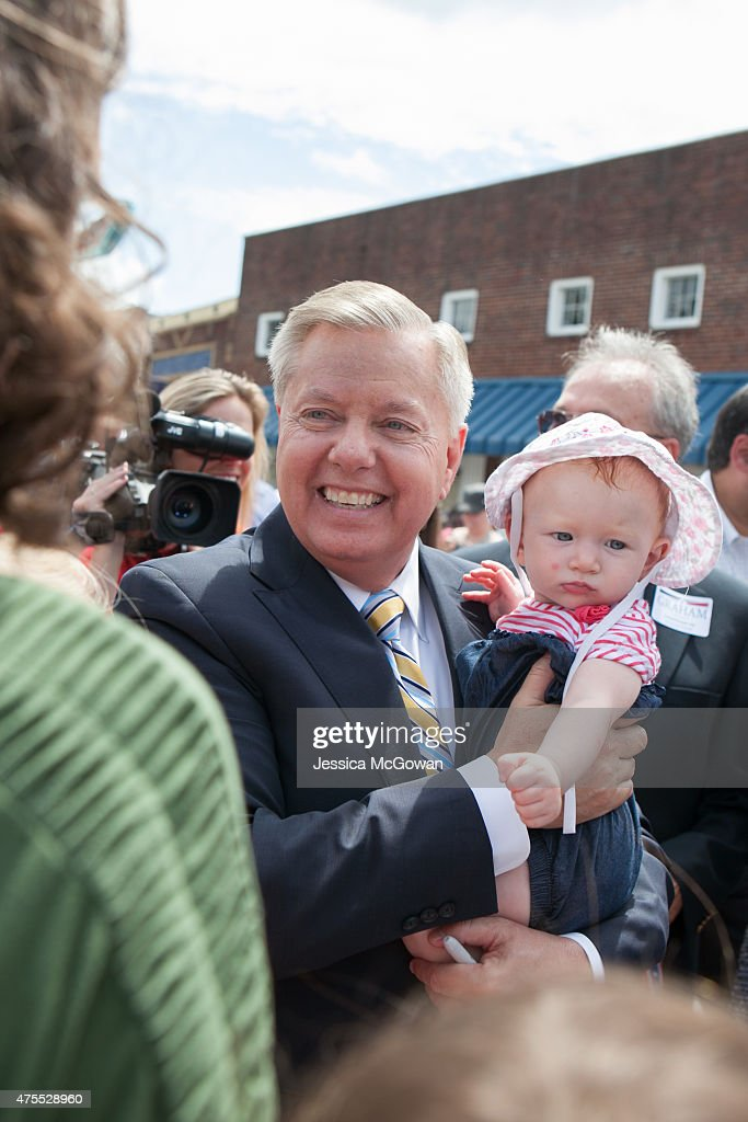 U.S. Sen. Lindsey Graham (R-SC) holds a supporter's baby after announcing his candidacy for United States President during an outdoor event on June 1, 2015 in Central, South Carolina. Graham is the ninth Republican to join the race for president in 2016.