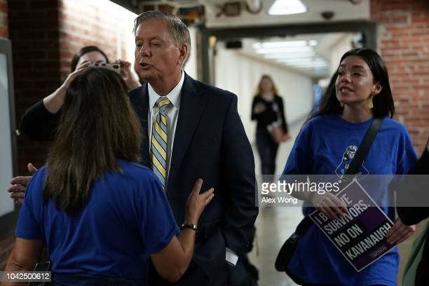 Sen. Lindsey Graham is confronted by protesters in the basement of Senate Russell Office Building September 28, 2018 on Capitol Hill in Washington,...
