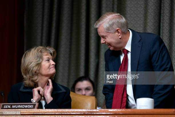Sen. Lindsey Graham , right, speaks to Sen. Lisa Murkowski during a Senate Appropriations Subcommittee on Commerce, Justice, Science, and Related...