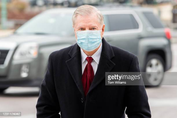 Sen. Lindsey Graham, R-S.C., arrives to the Capitol on the fourth day of former President Donald Trumps impeachment trial on Friday, February 12,...