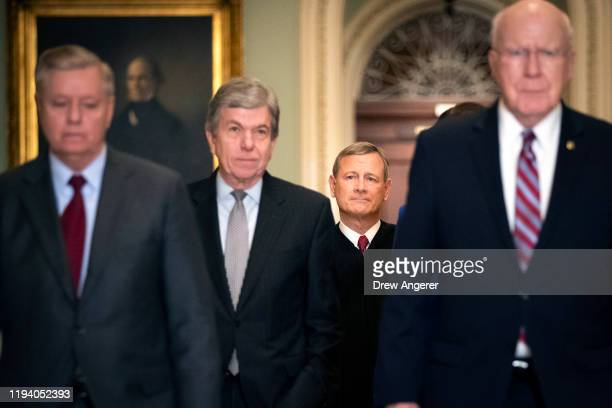 Sen Lindsey Graham Sen Roy Blunt Supreme Court Chief Justice John Roberts and Sen Pat Leahy arrive at the Senate chamber for impeachment proceedings...