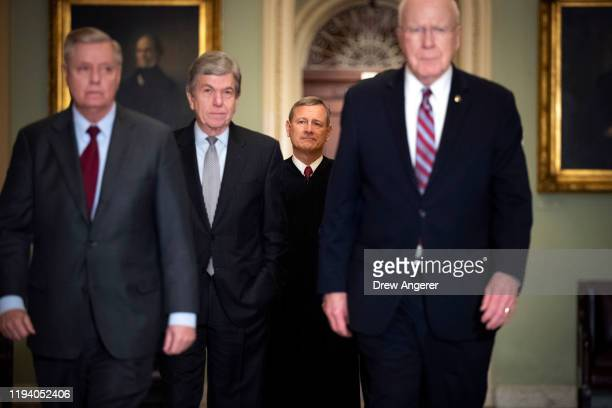Sen Lindsey Graham Sen Roy Blunt Supreme Court Chief Justice John Roberts and Sen Pat Leahy arrive to the Senate chamber for impeachment proceedings...