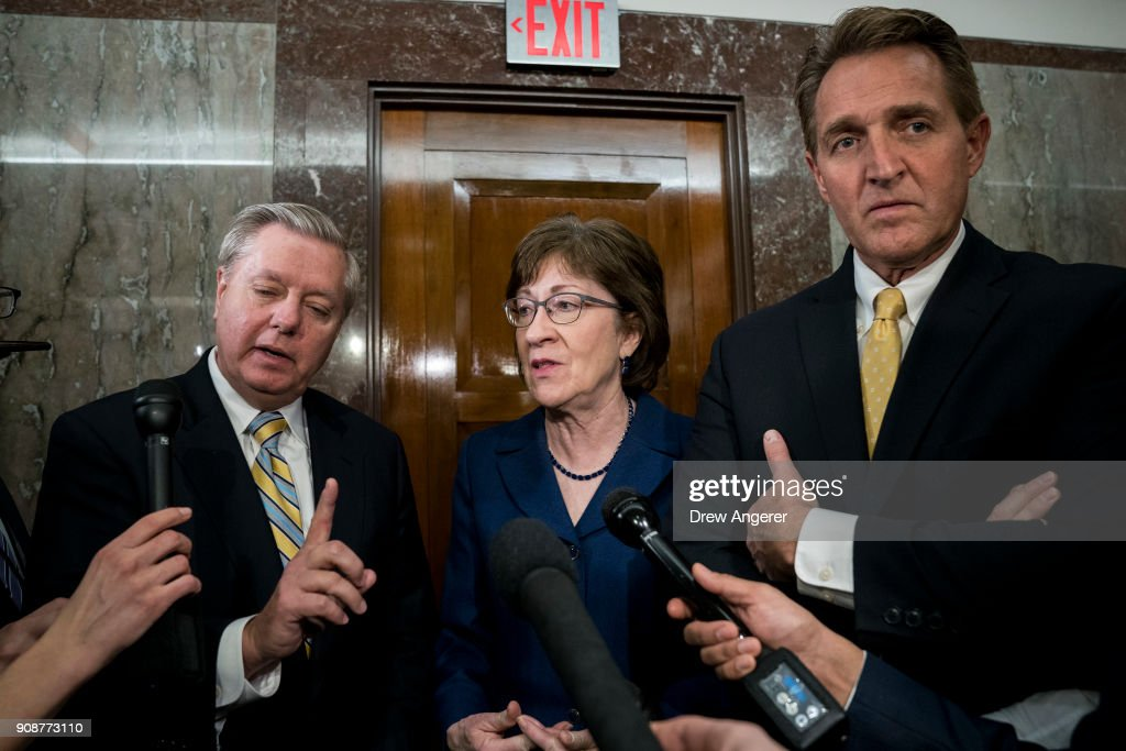 Sen. Lindsey Graham (R-SC), Sen. Susan Collins (R-ME) and Sen. Jeff Flake (R-AZ) talk to reporters after a meeting with a bipartisan group of moderate Senators in Collins' office on Capitol Hill, January 22, 2018 in Washington, DC. Lawmakers are continuing to seek a deal to end the government shutdown, now in day three.