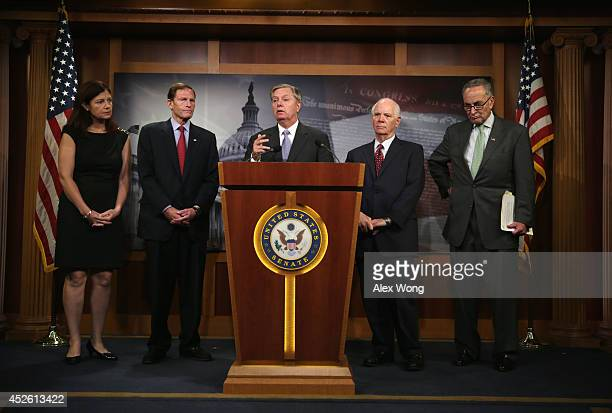 S Sen Lindsey Graham speaks as Sen Kelly Ayotte Sen Richard Blumenthal Sen Benjamin Cardin and Sen Charles Schumer listen during a news conference...