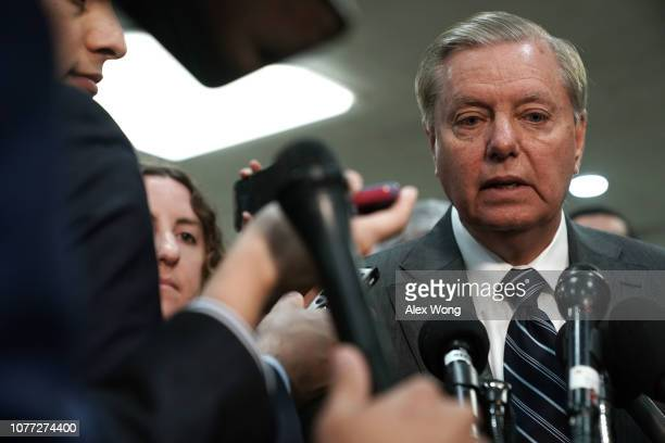 Sen Lindsey Graham speaks to members of the media after a closed door briefing by Central Intelligence Agency Director Gina Haspel to members of...