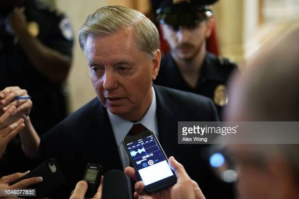 S Sen Lindsey Graham speaks to reporters after a cloture vote for the nomination of Supreme Court Judge Brett Kavanaugh to the US Supreme Court at...