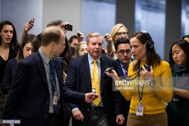 Sen Lindsey Graham speaks to reporters following a vote on Capitol Hill on January 11 2018 in Washington DC The house voted to reauthorize the...