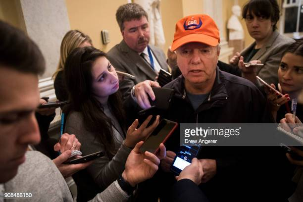 Sen Lindsey Graham speaks to reporters on Capitol Hill January 21 2018 in Washington DC Lawmakers are convening for a Sunday session to try to...