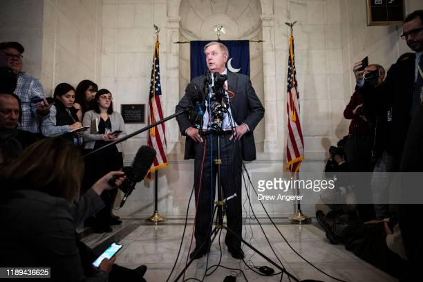 Sen. Lindsey Graham speaks to reporters outside of his office at the U.S. Capitol as debate on the articles of impeachment against President Trump...
