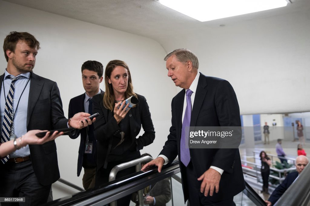 Sen. Lindsey Graham (R-SC) talks to reporters as he heads to a vote on amendments to the fiscal year 2018 budget resolution, on Capitol Hill, October 19, 2017 in Washington, DC. Thursday afternoon, the Senate kicked off a 'vote-a-rama;' a marathon voting session for amendments to the budget resolution.