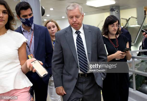 Sen. Lindsey Graham talks to reporters as he makes his way to the weekly Republican policy luncheons on Capitol Hill on May 25, 2021 in Washington,...