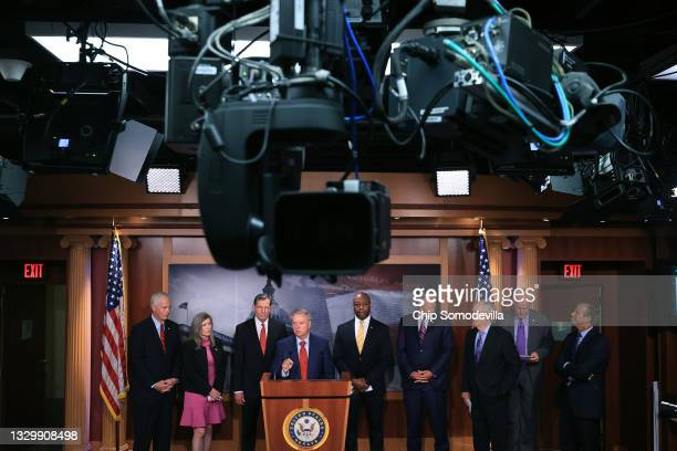 Sen. Lindsey Graham talks to reporters with Senate Minority Leader Mitch McConnell and other Senate Republicans during a news conference at the U.S....