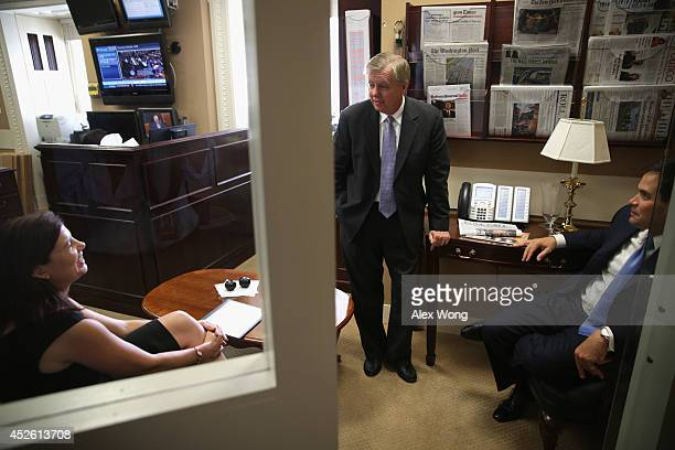 Sen. Lindsey Graham talks to Sen. Kelly Ayotte as Sen. Marco Rubio looks on prior to a news conference July 24, 2014 on Capitol Hill in Washington,...