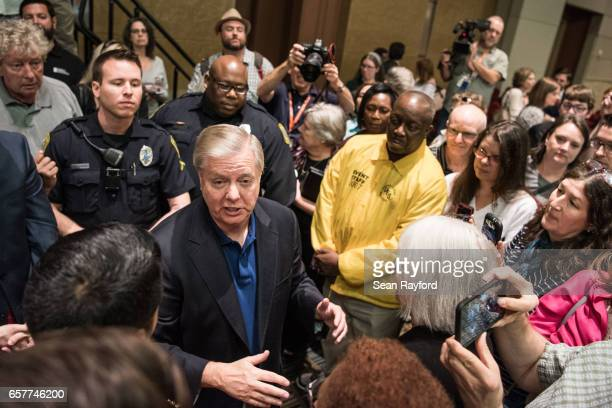 Sen Lindsey Graham talks with constituents after a town hall meeting March 25 2017 in Columbia South Carolina Protestors have been showing up in...