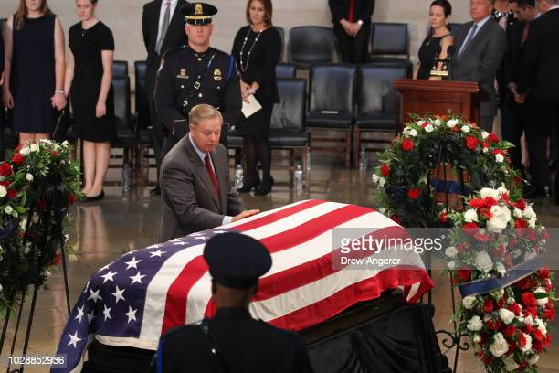S Sen Lindsey Graham touches the casket during the ceremony honoring the late US Senator John McCain inside the Rotunda of the US Capitol August 31...