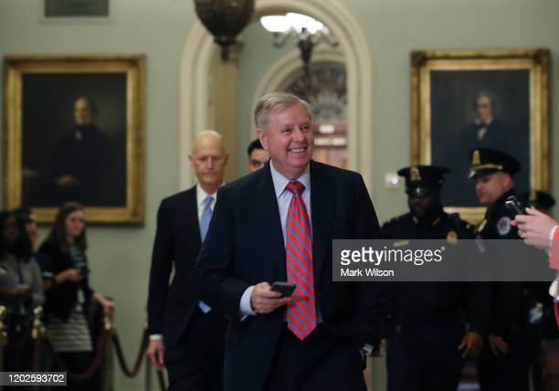 Sen Lindsey Graham walks to a GOP caucus meeting after President Donald Trump's impeachment trial ended for the day at the US Capitol on January 28...