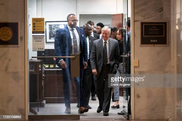 Sen. Lindsey Graham walks with members of the Floyd family and legal team as they depart the office Sen. Tim Scott after the Floyd family met with...