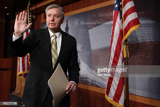Sen. Lindsey Graham waves at the end of a news conference March 6, 2013 on Capitol Hill in Washington, DC. The senators held a news conference on...