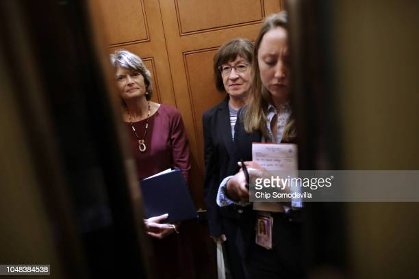Sen. Lisa Murkowski and Sen. Susan Collins share an elevator as they head for the weekly Senate Republican policy luncheon at the U.S. Capitol...