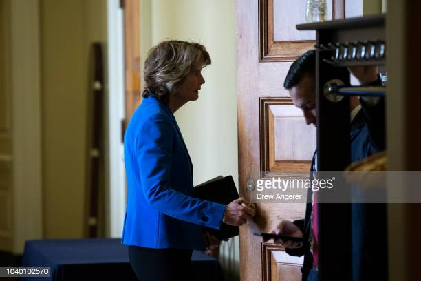 Sen Lisa Murkowski arrives for the weekly GOP policy luncheon on Capitol Hill September 25 2018 in Washington DC Christine Blasey Ford who has...