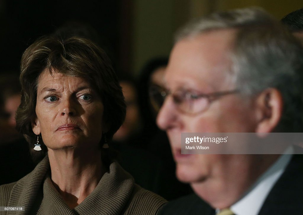 Sen. Lisa Murkowski (R-AK), chairman of the Senate Energy and Natural Resources Committee, listens to by Senate Majority Leader Mitch McConnell (R-KY), speak to the media after the weekly Senate Policy Luncheon on Capitol Hill January 27, 2016 in Washington, DC. The Senators discussed theÊcomprehensive energy legislation that is before the Senate.