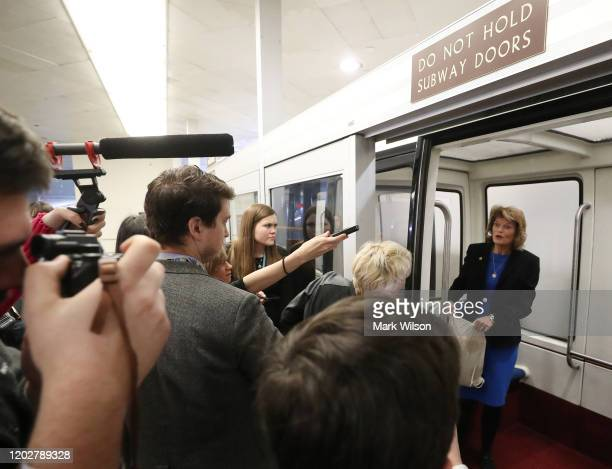 Sen Lisa Murkowski is approached by reporters in the Senate subway before attending the Senate impeachment trial at the US Capitol on January 29 2020...