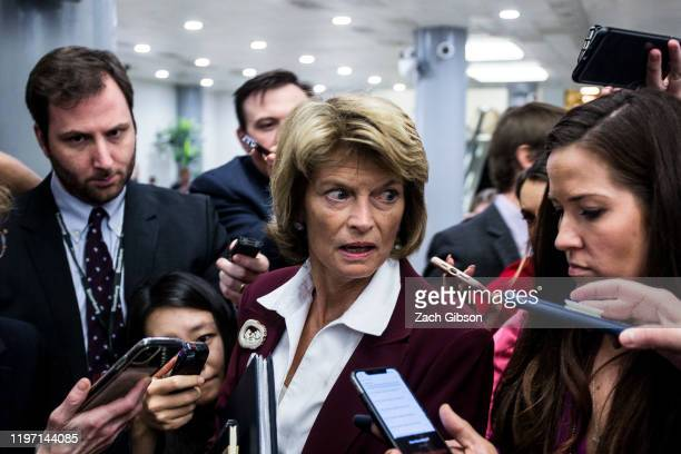 Sen. Lisa Murkowski leaves a closed-door Senate Republican caucus meeting after the Senate adjourned for the day during the Senate impeachment trial...
