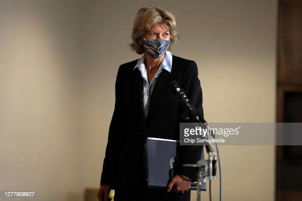 Sen. Lisa Murkowski leaves the weekly Senate Republican policy luncheon in the Hart Senate Office Building on Capitol Hill on September 30, 2020 in...