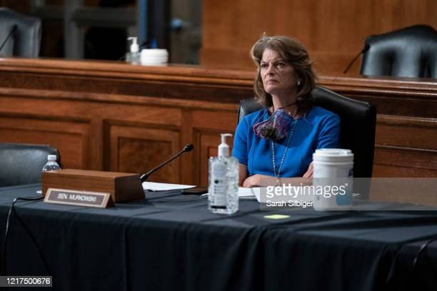 Sen. Lisa Murkowski listens during a Senate Health, Education, Labor, and Pensions hearing on a plan for students to safely return to college amid...