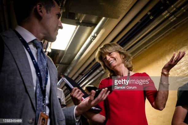 Sen. Lisa Murkowski reacts to questions from reporters as she leaves a bipartisan meeting on infrastructure in the basement of the U.S. Capitol...