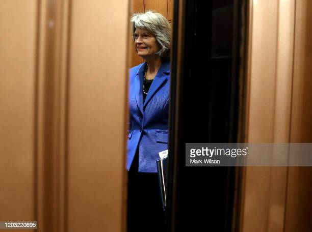 Sen. Lisa Murkowski rides an elevator to the Senate floor after announcing that she will vote against subpoenaing witnesses in the impeachment trial...