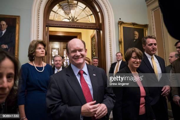 Sen Lisa Murkowski Sen Lindsey Graham Chris Coons Sen Amy Klobuchar and Sen Jeff Flake emerge from the Senate floor after the Senate passed a...