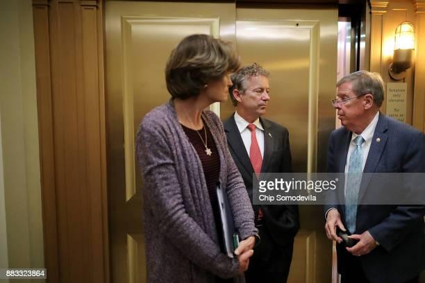 Sen Lisa Murkowski Sen Rand Paul and Sen Johnny Isakson visit in between votes at the US Capitol November 30 2017 in Washington DC The Senate is...
