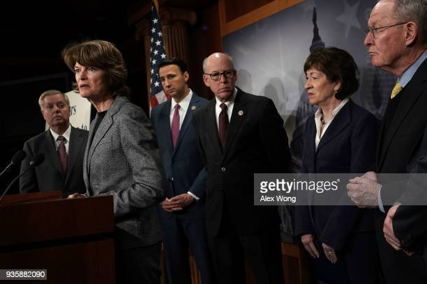 S Sen Lisa Murkowski speaks as Sen LIndsey Graham Rep Ryan Costello Rep Greg Walden Sen Susan Collins and Sen Lamar Alexander listen during a news...