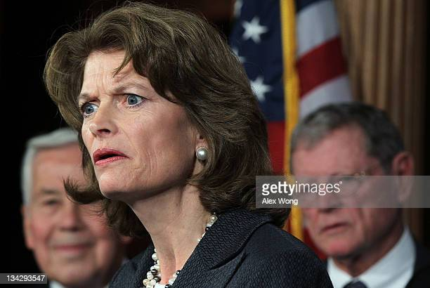 Sen. Lisa Murkowski speaks as U.S. Sen. Richard Lugar and U.S. Sen. James Inhofe listen during a news conference November 30, 2011 on Capitol Hill in...