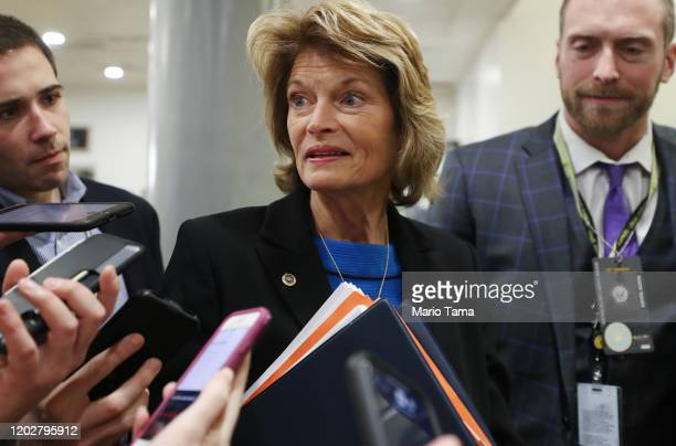 Sen. Lisa Murkowski speaks to reporters as she arrives for the continuation of the Senate impeachment trial of President Donald Trump at the U.S....