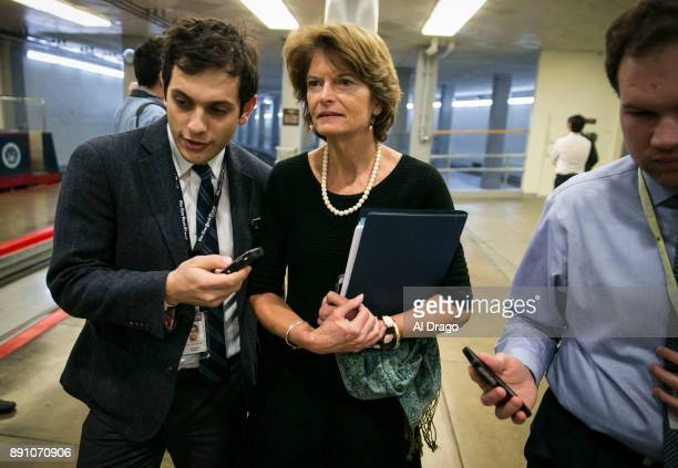 S Sen Lisa Murkowski speaks with reporters as she arrives for the weekly Senate Republican's policy luncheon on Capitol Hill December 12 2017 in...