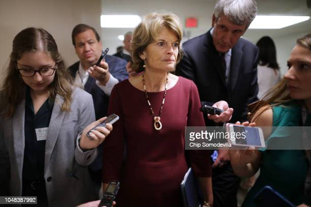 Sen. Lisa Murkowski talks with reporters as she heads for the weekly Senate Republican policy luncheon at the U.S. Capitol October 02, 2018 in...