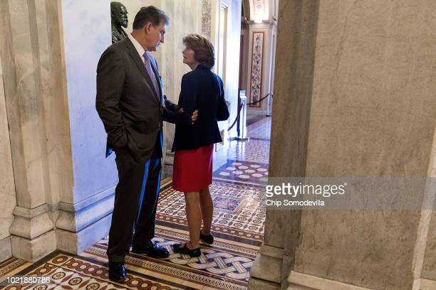 Sen Lisa Murkowski talks with Sen Joe Manchin in the halls of the US Capitol August 23 2018 in Washington DC Later in the day Murkowski is scheduled...