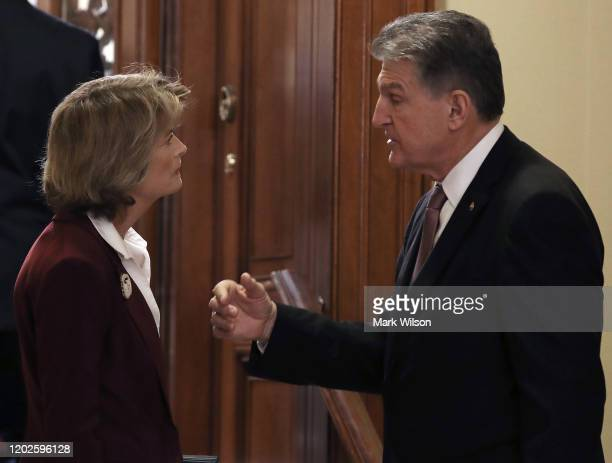 Sen Lisa Murkowski talks with Sen Joe Manchin outside of the Senate Chamber before a Senate GOP caucus meeting at the US Capitol on January 28 2020...