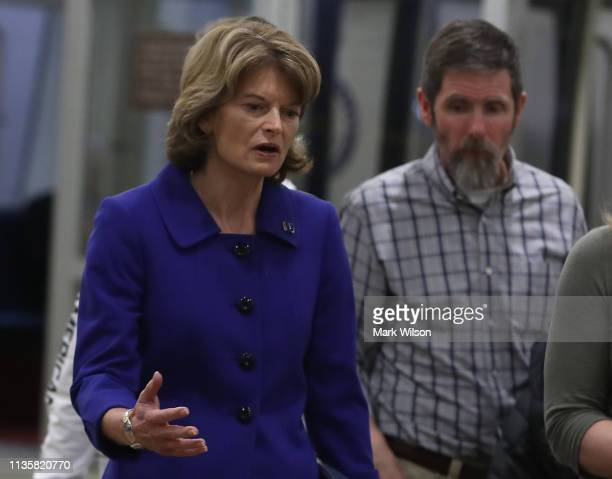 Sen Lisa Murkowski walks through the US Capitol prior to the Senate voting to overturn the President's national emergency border declaration at the...