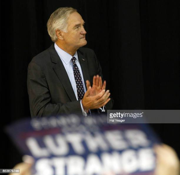 Sen Luther Strange applauds as he listens to Vice President Mike Pence speak at a campaign rally at HealthSouth Aviation on September 25 2017 in...
