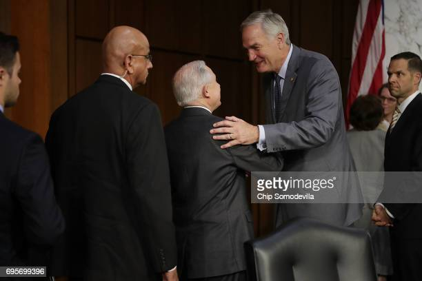 Sen Luther Strange shakes hands with US Attorney General Jeff Sessions after he testified before the Senate Intelligence Committee about Russian...