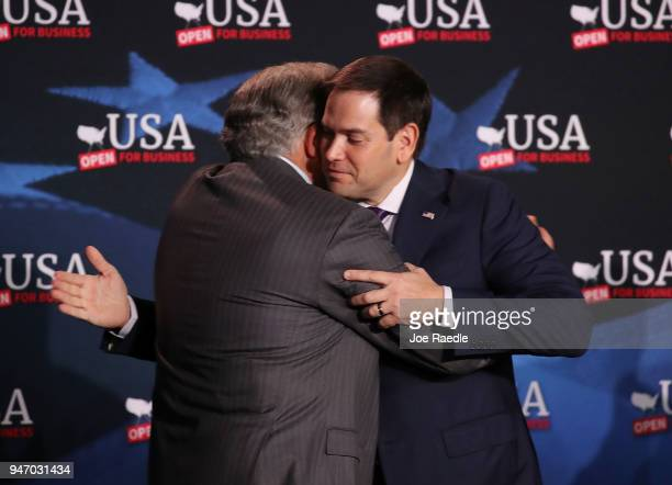 Sen Marco Rubio greets Maximo Alvarez as he arrives for a roundtable discussion with President Donald Trump about the Republican $15 trillion tax cut...