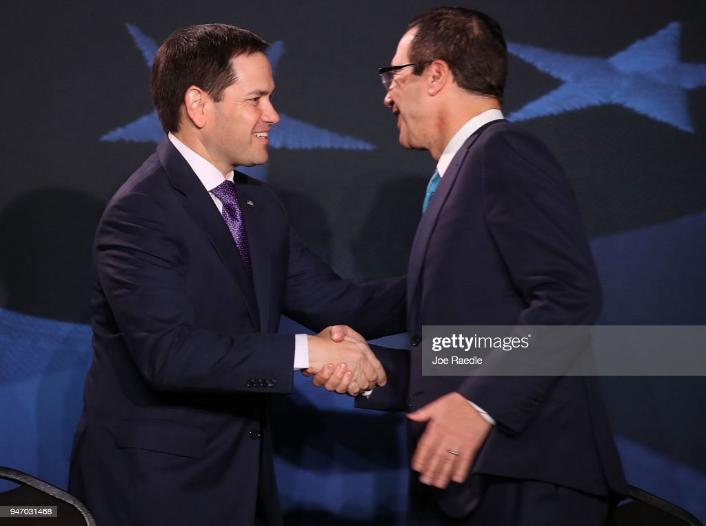 U.S. Sen. Marco Rubio (R-FL) (L) greets Treasury Secretary Steven Mnuchin before a roundtable discussion with President Donald Trump about the Republican $1.5 trillion tax cut package he recently signed into law on April 16, 2018 in Hialeah, Florida. Trump was joined by local business owners Labor Secretary Alex Acosta and others.