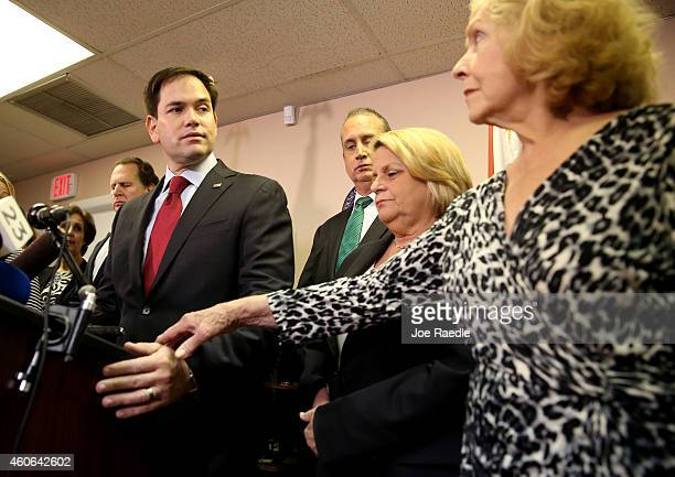 Sen Marco Rubio prepares to speak as Mirta Costa the mother of Carlos Costa a pilot from a group called Brothers to the Rescue who was shot down by...