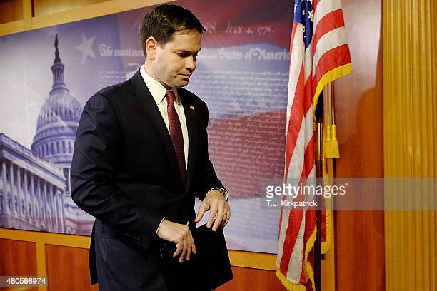 Sen Marco Rubio reacts to US President Barack Obama's announcement about revising policies on USCuba relations on December 17 2014 in Washington DC...
