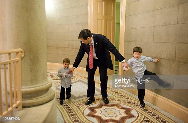 Sen Marco Rubio RFla and his sons Anthony right and Dominic make their way to a swearing in ceremony for the 112th Congress in the Old Senate Chamber...