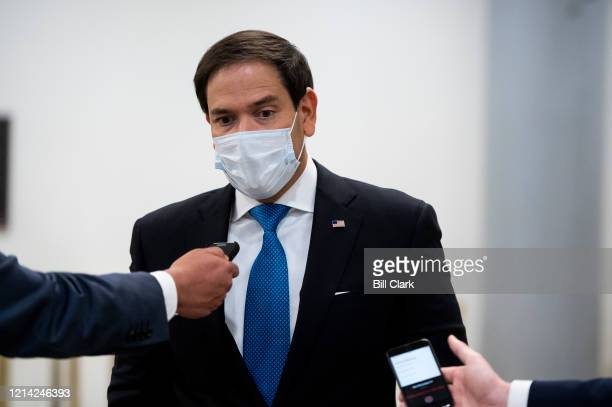 Sen Marco Rubio RFla stops to speak with reporters on his way to the Senate floor to vote on Wednesday May 20 2020