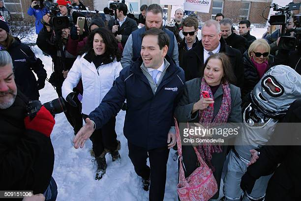 Sen Marco Rubio shakes hands while thanking supporters outside the polling place at Webster School February 9 2016 in Manchester New Hampshire With a...